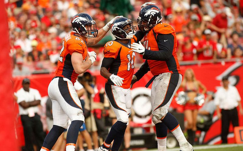 TAMPA, FL - OCTOBER 2:  Wide receiver Emmanuel Sanders #10 of the Denver Broncos celebrates his touchdown with teammates tight end Jeff Heuerman #82 and offensive tackle Ty Sambrailo #74 during the fourth quarter of an NFL game against the Tampa Bay Buccaneers on October 2, 2016 at Raymond James Stadium in Tampa, Florida. (Photo by Brian Blanco/Getty Images)