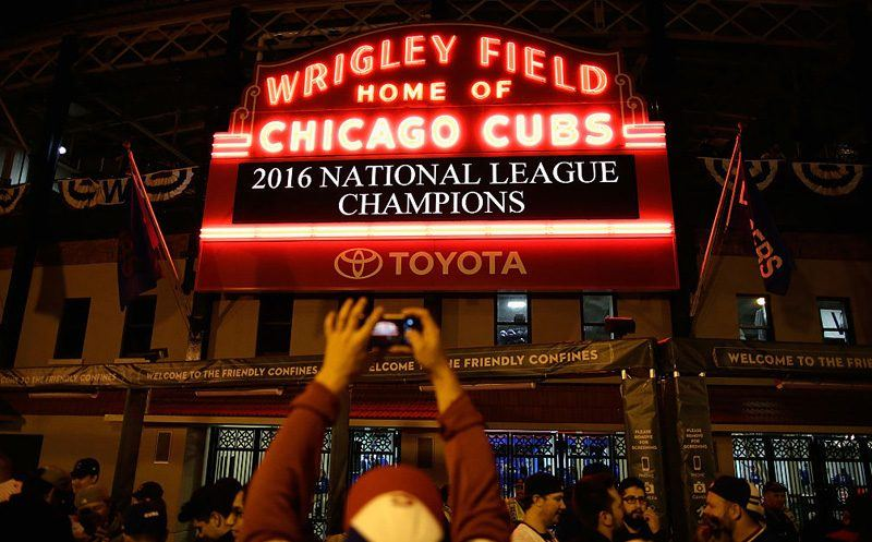 CHICAGO, IL - OCTOBER 22:  Chicago Cubs fans celebrate outside of Wrigley Field after the Chicago Cubs defeated the Los Angeles Dodgers 5-0 in game six of the National League Championship Series to advance to the World Series against the Cleveland Indians on October 22, 2016 in Chicago, Illinois.  (Photo by Jamie Squire/Getty Images)