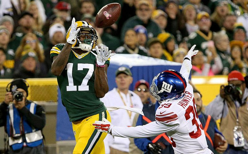 GREEN BAY, WI - OCTOBER 09:  Davante Adams #17 of the Green Bay Packers makes a catch over Michael Hunter #39 of the New York Giants in the second quarter at Lambeau Field on October 9, 2016 in Green Bay, Wisconsin. (Photo by Dylan Buell/Getty Images)