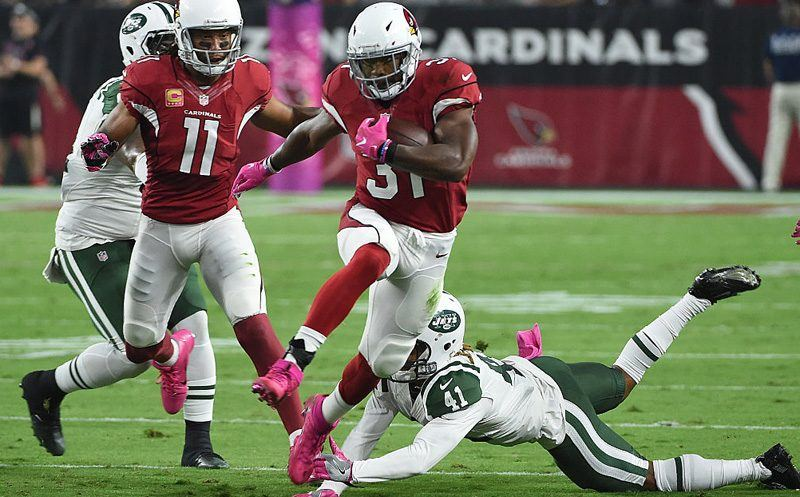 GLENDALE, AZ - OCTOBER 17:  Running back David Johnson #31 of the Arizona Cardinals jumps over cornerback Buster Skrine #41 of the New York Jets then runs the football 58 yards to score a touchdown in the first quarter at University of Phoenix Stadium on October 17, 2016 in Glendale, Arizona.  (Photo by Norm Hall/Getty Images)