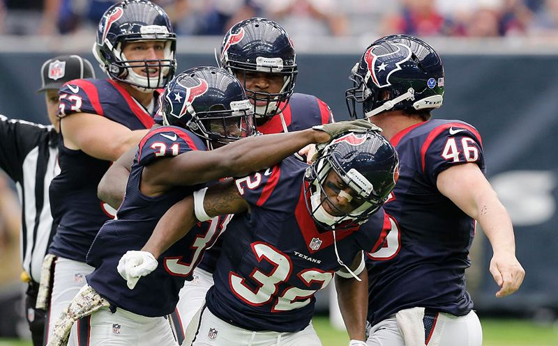 HOUSTON, TX - OCTOBER 30:  Robert Nelson #32 of the Houston Texans is congratulated by Charles James #31 of the Houston Texans after making a tackle on a kickoff return in the third quarter against the Detroit Lions at NRG Stadium on October 30, 2016 in Houston, Texas.  (Photo by Thomas B. Shea/Getty Images)