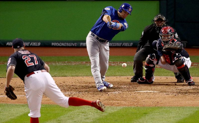 CLEVELAND, OH - OCTOBER 26:  Kyle Schwarber #12 of the Chicago Cubs hits an RBI single to score Ben Zobrist #18 (not pictured) during the fifth inning against the Cleveland Indians in Game Two of the 2016 World Series at Progressive Field on October 26, 2016 in Cleveland, Ohio.  (Photo by Elsa/Getty Images)