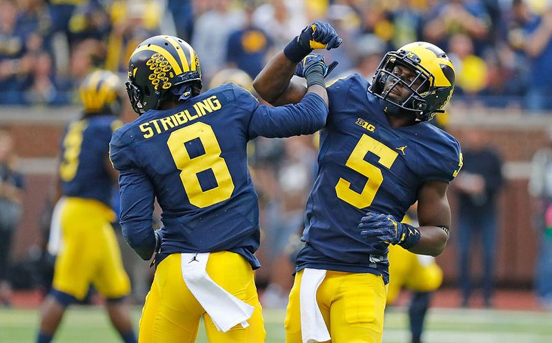 ANN ARBOR, MI - OCTOBER 01: Channing Stribling #8 and  teammate Jabrill Peppers #5 of the Michigan Wolverines celebrate a stop for a loss during the second quarter of the game against the Wisconsin Badgers at Michigan Stadium on October 1, 2016 in Ann Arbor, Michigan. (Photo by Leon Halip/Getty Images)