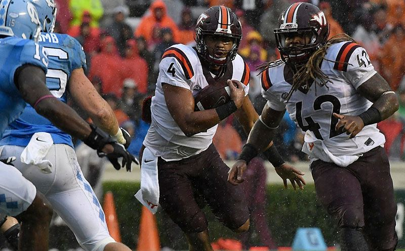 CHAPEL HILL, NC - OCTOBER 08:  Jerod Evans #4 of the Virginia Tech Hokies runs against the UNC Tar Heels at Kenan Stadium on October 8, 2016 in Chapel Hill, North Carolina. (Photo by Mike Comer/Getty Images)