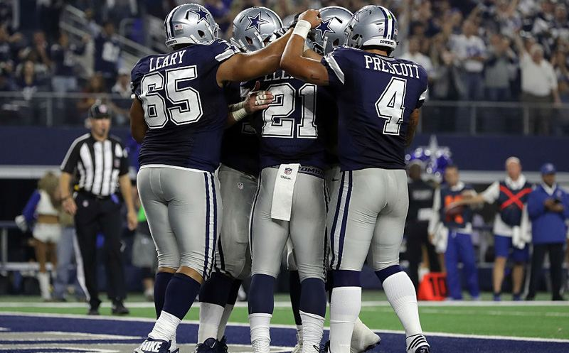 ARLINGTON, TX - NOVEMBER 24:   Ezekiel Elliott #21 of the Dallas Cowboys celebrates with teammates after scoring a touchdown during the fourth quarter against the Washington Redskins at AT&T Stadium on November 24, 2016 in Arlington, Texas.  (Photo by Ronald Martinez/Getty Images)