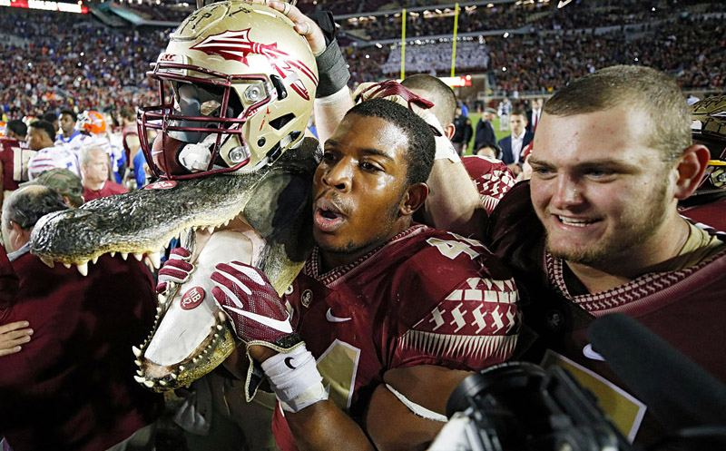TALLAHASSEE, FL - NOVEMBER 26: DeMarcus Walker #44 of the Florida State Seminoles carries a gator head wearing his helmet as he celebrates after the game against the Florida Gators at Doak Campbell Stadium on November 26, 2016 in Tallahassee, Florida. Florida State defeated Florida 31-13. (Photo by Joe Robbins/Getty Images)
