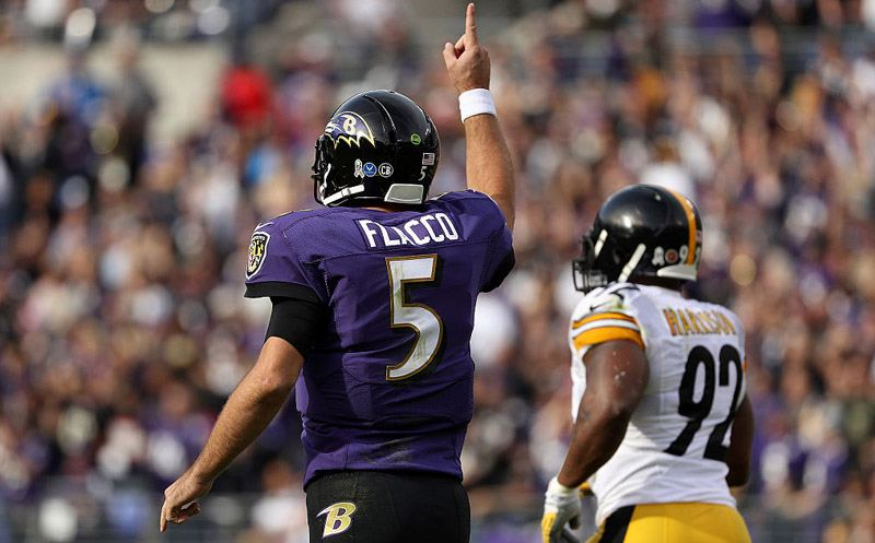 LANDOVER, MD - OCTOBER 16: Quarterback Joe Flacco #5 of the Baltimore Ravens celebrates after throwing a first quarter touchdown pass to teammate wide receiver Mike Wallace #17 (not pictured) against the Pittsburgh Steelers at FedExField on October 16, 2016 in Landover, Maryland. (Photo by Patrick Smith/Getty Images)