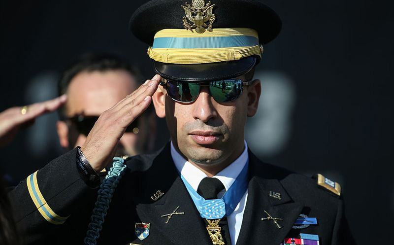 CHICAGO, IL - DECEMBER 06:  Medal of Honor recipient, Captain Florent Groberg, stands for the national anthem during pre-game ceremonies prior to the NFL game between the Chicago Bears and the San Francisco 49ers at Soldier Field on December 6, 2015 in Chicago, Illinois.  (Photo by Jonathan Daniel/Getty Images)