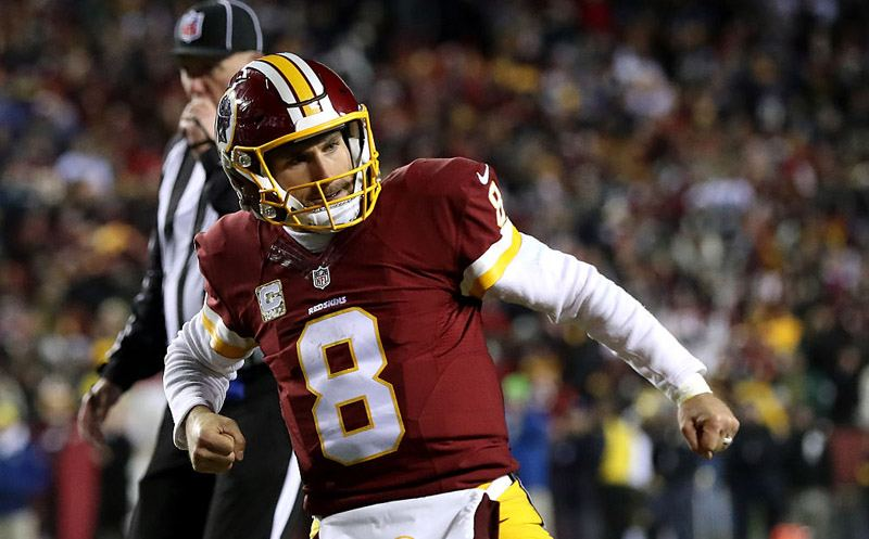 LANDOVER, MD - NOVEMBER 20: Quarterback Kirk Cousins #8 of the Washington Redskins celebrates after teammate running back Rob Kelley #32 (not pictured) scores a fourth quarter touchdown against the Green Bay Packers at FedExField on November 20, 2016 in Landover, Maryland. (Photo by Rob Carr/Getty Images)