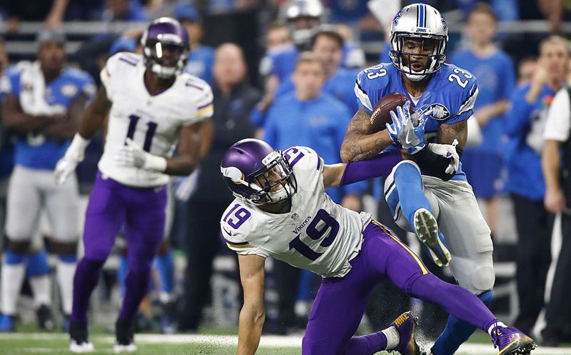 DETROIT.MI - NOVEMBER 24: Darius Slay (23) of the Detroit Lions intercepts a pass in front of Adam Thielen (19) of the Minnesota Vikings with 30 seconds left in the fourth quarter at Ford Field on November 24, 2016 in Detroit, Michigan. The Lions kicked a field goal as time ran out to defeat the Minnesota Vikings 16-13. (Photo by Gregory Shamus/Getty Images)