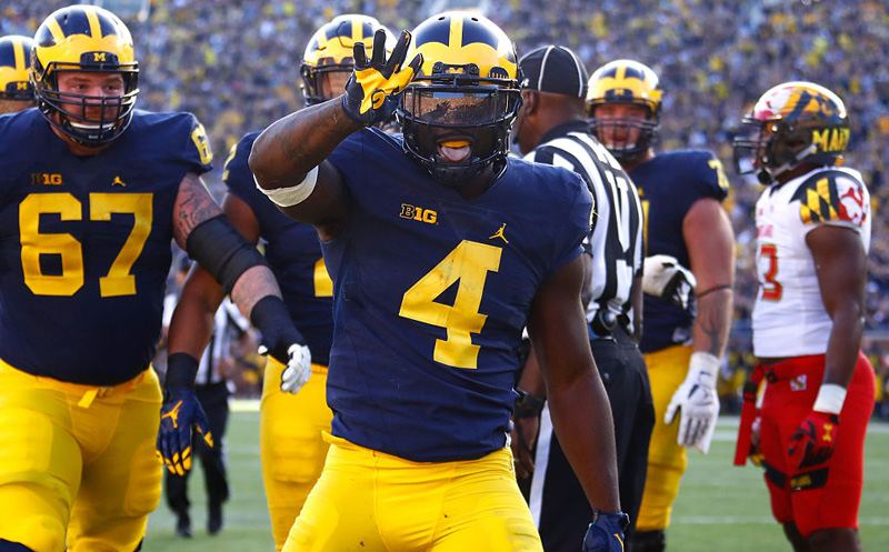 ANN ARBOR, MI - NOVEMBER 05: De'Veon Smith #4 of the Michigan Wolverines celebrates a first half touchdown in front of teammate Kyle Kalis #67 while playing the Maryland Terrapins on November 5, 2016 at Michigan Stadium in Ann Arbor, Michigan. (Photo by Gregory Shamus/Getty Images)