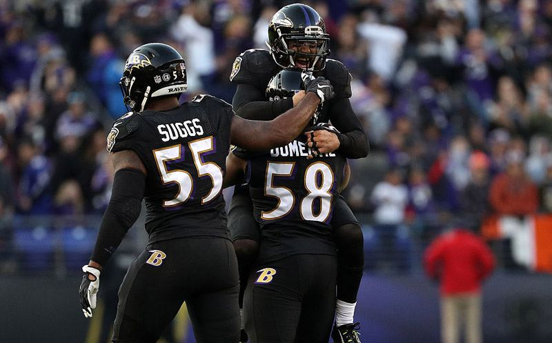 BALTIMORE, MD - NOVEMBER 27: Outside linebacker Elvis Dumervil #58 of the Baltimore Ravens reacts with teammates Strong safety Eric Weddle #32 and outside linebacker Terrell Suggs #55 after forcing a fumble against the Cincinnati Bengals in the fourth quarter at M&T Bank Stadium on November 27, 2016 in Baltimore, Maryland. (Photo by Patrick Smith/Getty Images)