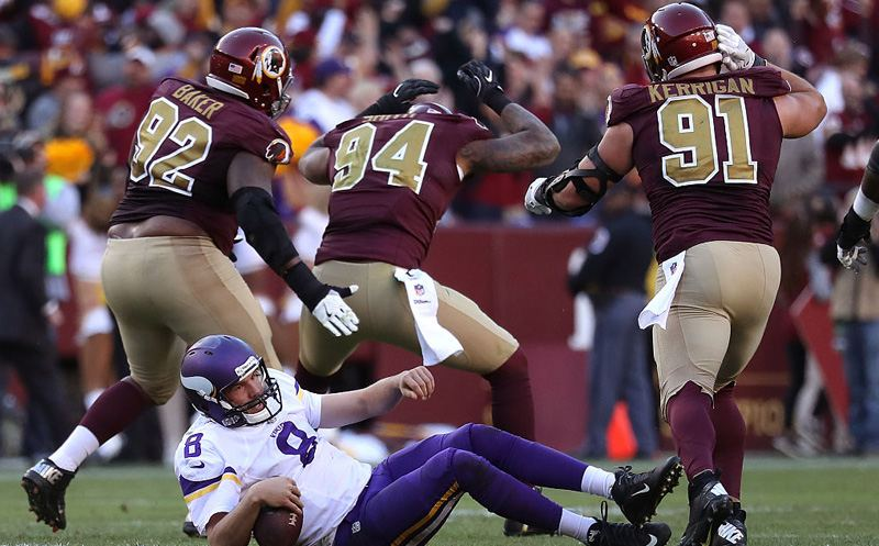 LANDOVER, MD - NOVEMBER 13: Quarterback Sam Bradford #8 of the Minnesota Vikings is sacked by outside linebacker Preston Smith #94 of the Washington Redskins in the fourth quarter at FedExField on November 13, 2016 in Landover, Maryland. (Photo by Rob Carr/Getty Images)