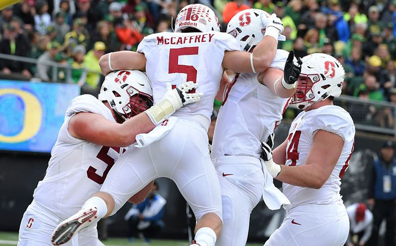 EUGENE, OR - NOVEMBER 12: Running back Christian McCaffrey #5 of the Stanford Cardinal celebrates with teammates after scoring a touchdown during the first quarter of the game against the Oregon Ducks at Autzen Stadium on November 12, 2016 in Eugene, Oregon. (Photo by Steve Dykes/Getty Images)
