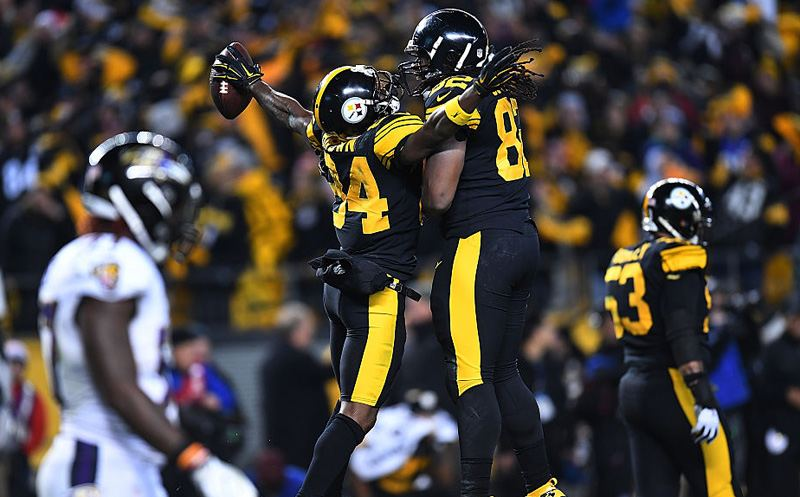 PITTSBURGH, PA - DECEMBER 25:  Antonio Brown #84 of the Pittsburgh Steelers celebrates with David Johnson #82 after catching a 4 yard touchdown pass in the fourth quarter during the game against the Baltimore Ravens at Heinz Field on December 25, 2016 in Pittsburgh, Pennsylvania. (Photo by Joe Sargent/Getty Images)