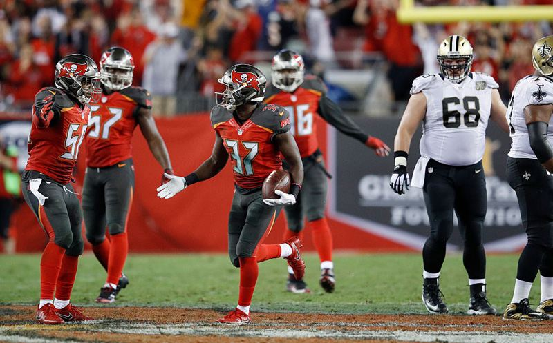 TAMPA, FL - DECEMBER 11: Keith Tandy #37 of the Tampa Bay Buccaneers celebrates with teammates after an interception in the fourth quarter of the game against the New Orleans Saints at Raymond James Stadium on December 11, 2016 in Tampa, Florida. Tampa Bay defeated New Orleans 16-11. (Photo by Joe Robbins/Getty Images)