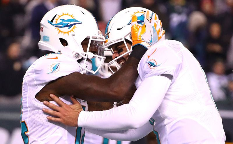 EAST RUTHERFORD, NJ - DECEMBER 17:  Matt Moore #8 of the Miami Dolphins celebrates with Jarvis Landry #14 after scoring a touchdown against the New York Jets during the third quarter of the game at MetLife Stadium on December 17, 2016 in East Rutherford, New Jersey.  (Photo by Al Bello/Getty Images)