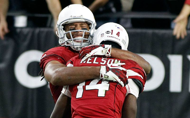 GLENDALE, AZ - DECEMBER 04:  Larry Fitzgerald #11 of the Arizona Cardinals embraces teammate J.J. Nelson #14 after Nelson's touchdown catch against the Washington Redskins during the fourth quarter of a game at University of Phoenix Stadium on December 4, 2016 in Glendale, Arizona.  (Photo by Ralph Freso/Getty Images)