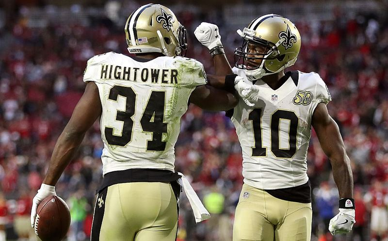 GLENDALE, AZ - DECEMBER 18:  Running back Tim Hightower #34 of the New Orleans Saints is congratulated by wide receiver Brandin Cooks #10 after scoring a two yard rushing touchdown in the fourth quarter against the Arizona Cardinals at the University of Phoenix Stadium on December 18, 2016 in Glendale, Arizona. The Saints defeated the Cardinals 48-41.  (Photo by Christian Petersen/Getty Images)