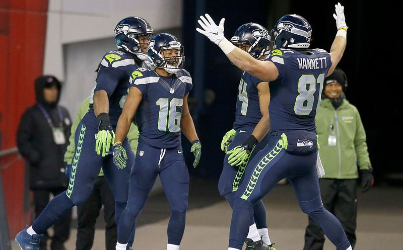 SEATTLE, WA - DECEMBER 04:  Seattle Seahawks players congratulate teammate Wide receiver Tyler Lockett #16 after he scored a touchdown against the Carolina Panthers at CenturyLink Field on December 4, 2016 in Seattle, Washington.  (Photo by Otto Greule Jr/Getty Images)
