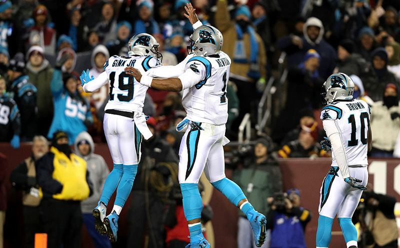 LANDOVER, MD - DECEMBER 19: Wide receiver Ted Ginn #19 of the Carolina Panthers celebrates with teammate quarterback Cam Newton #1 of the Carolina Panthers after scoring a first quarter touchdown against the Washington Redskins at FedExField on December 19, 2016 in Landover, Maryland. (Photo by Patrick Smith/Getty Images)