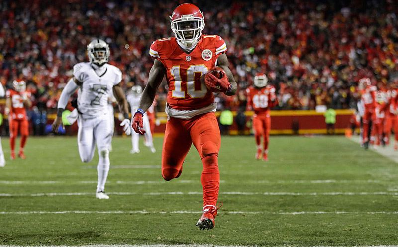 KANSAS CITY, MO - DECEMBER 8: Wide receiver Tyreek Hill #10 of the Kansas City Chiefs runs in to the end zone on a punt return for a touchdown against the Oakland Raiders at Arrowhead Stadium during the second quarter of the game on December 8, 2016 in Kansas City, Missouri. (Photo by Jamie Squire/Getty Images)