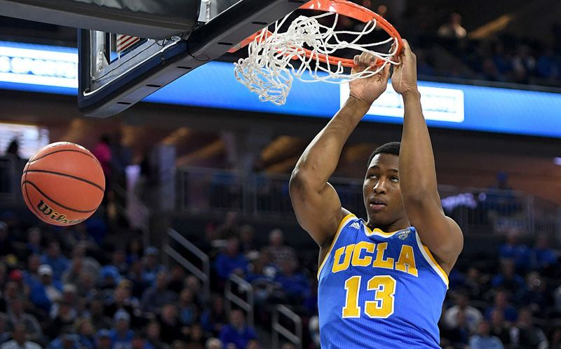 LAS VEGAS, NV - DECEMBER 17:  Ike Anigbogu #13 of the UCLA Bruins dunks against the Ohio State Buckeyes during the CBS Sports Classic at T-Mobile Arena on December 17, 2016 in Las Vegas, Nevada. UCLA won 86-73.  (Photo by Ethan Miller/Getty Images)