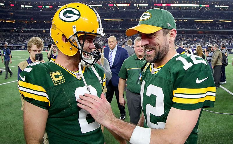 ARLINGTON, TX - JANUARY 15:  Mason Crosby #2 of the Green Bay Packers celebrates with Aaron Rodgers #12 of the Green Bay Packers after kicking the game winning field goal against the Dallas Cowboys in the final seconds of a NFC Divisional Playoff game at AT&T Stadium on January 15, 2017 in Arlington, Texas. The Green Bay Packers beat the Dallas Cowboys 34-31  (Photo by Tom Pennington/Getty Images)