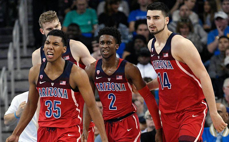 LOS ANGELES, CA - JANUARY 21: Kobi Simmons #2 of the Arizona Wildcats is congratulated by his teammates Dusan Ristic #14 and Allonzo Trier #35 after he scored a basket against UCLA during the second half of the game at Pauley Pavilion on January 21, 2017 in Los Angeles, California. Arizona defeated UCLA, 96-85.  (Photo by Kevork Djansezian/Getty Images)
