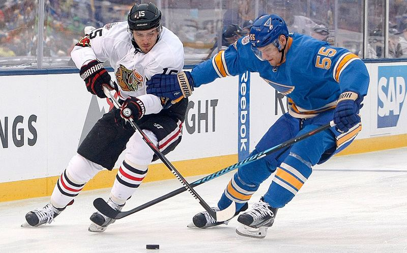 ST. LOUIS, MO - JANUARY 2: Artem Anisimov #15 of the Chicago Blackhawks handles the puck as Colton Parayko #55 of the St. Louis Blues defends during the third period of the 2017 Bridgestone NHL Winter Classic at Busch Stadium on January 2, 2017 in St. Louis, Missouri. (Photo by Scott Kane/Getty Images)