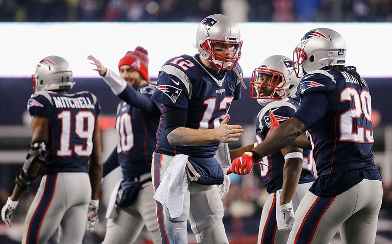 FOXBORO, MA - JANUARY 22:  Tom Brady #12 of the New England Patriots celebrates with LeGarrette Blount #29 after throwing a touchdown pass to Julian Edelman #11 (not pictured) during the third quarter against the Pittsburgh Steelers in the AFC Championship Game at Gillette Stadium on January 22, 2017 in Foxboro, Massachusetts.  (Photo by Jim Rogash/Getty Images)