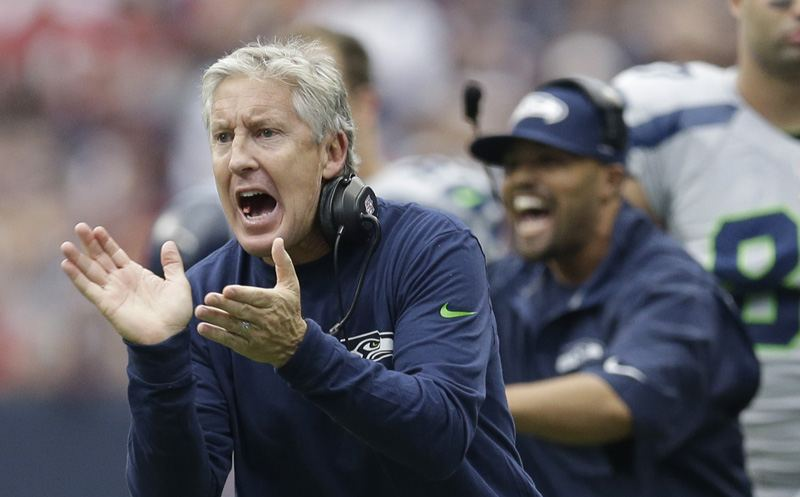 Seattle Seahawks head coach Pete Carroll talks to his players during the first quarter an NFL football game against the Houston Texans, Sunday, Sept. 29, 2013, in Houston. (AP Photo/David J. Phillip)