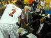 Russ Smith shakes John Thompson\'s hand