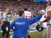 Giants players run on the field to celebrate