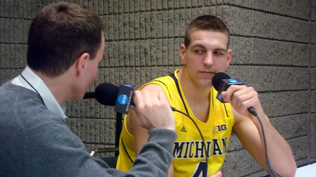 Kevin Kugler talks with Mitch McGary at the Final Four.
