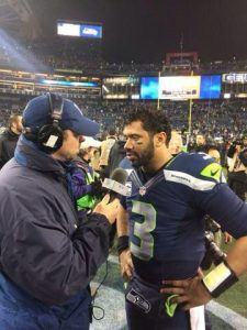 Scott Kaplan talks with Russell Wilson after the Seahawks take down the Carolina Panthers.
