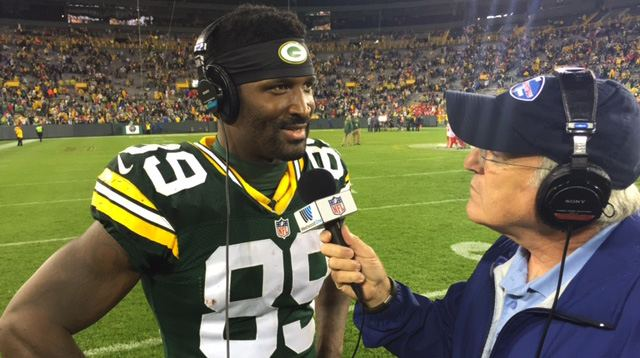 James Jones speaks with Hub Arkush after Green Bay's 38-28 win on Monday night. (Lance Davis/Westwood One)